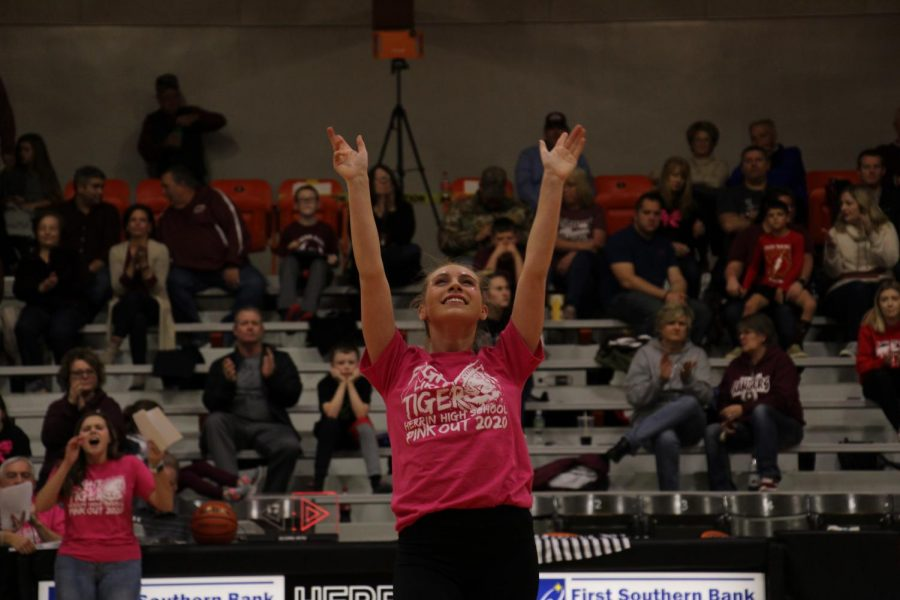 Shanie May (12) ends pom with a smile during the PINKOUT game.