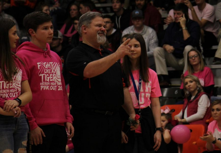 Mr.+Johnson+points+out+one+of+his+supporters+during+the+Rose+Walk+at+halftime+of+the+Pink+Out+game.