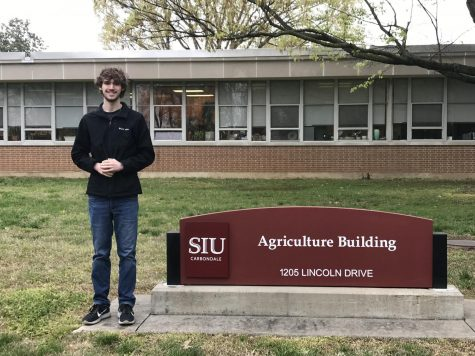 Zoller (12) smiling with pride at his college of choice.