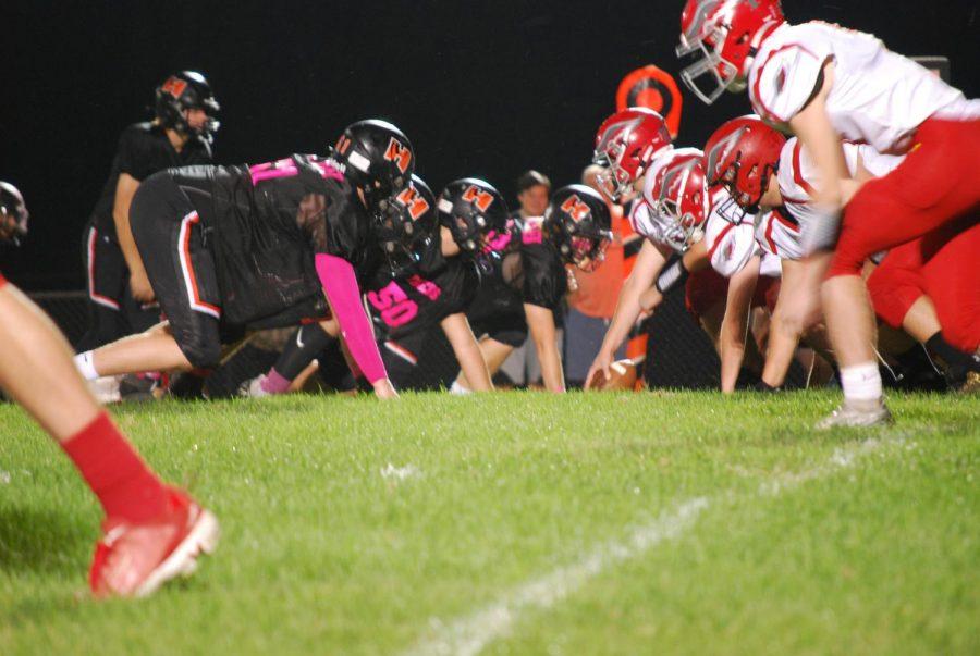 Varsity boys line up their defense against the Redbirds.