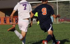 Jesus Mendez (12) dribbles the ball toward the goal.